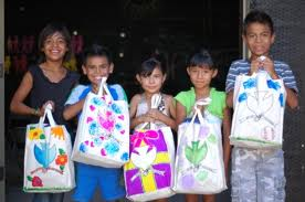 kids holding bags