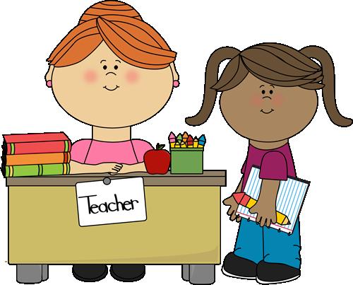 student-at-teachers-desk